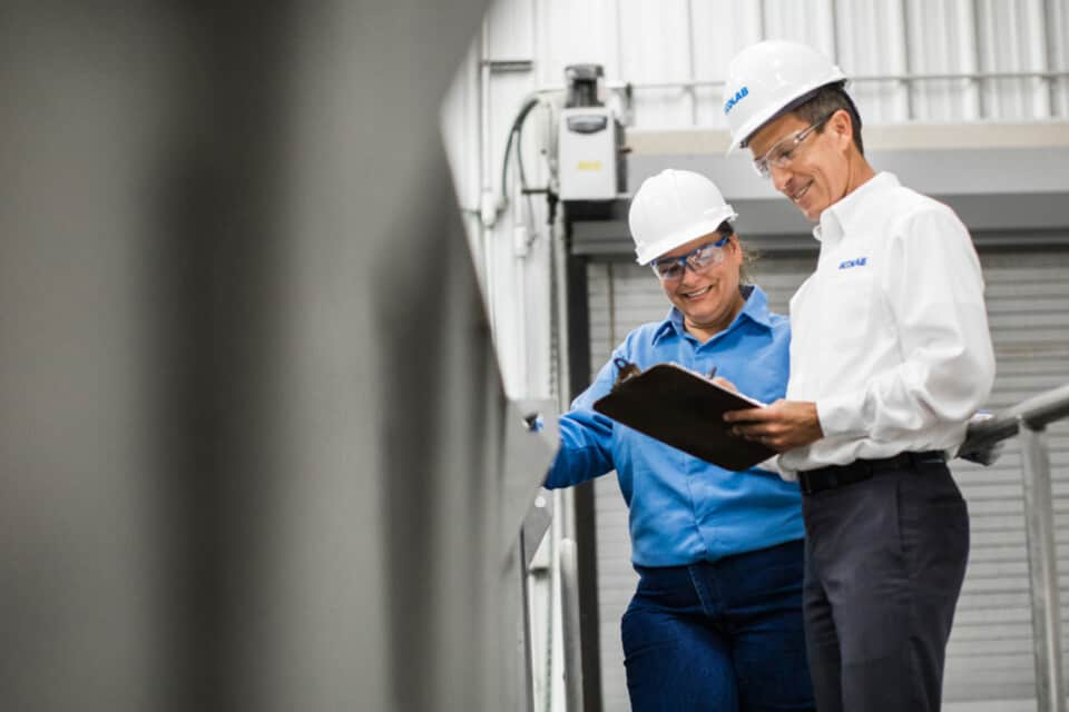 a plant manager consults with her Ecolab representative
